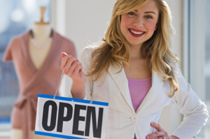 Photo of a business owner opening store