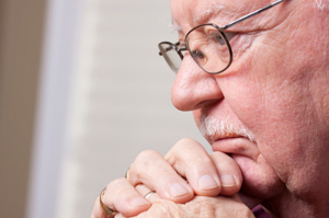 Photo of an elderly man in deep thought