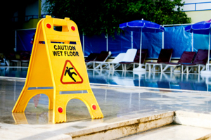 Photo of a wet floor sign by a pool