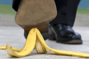 Guy slipping on banana peel